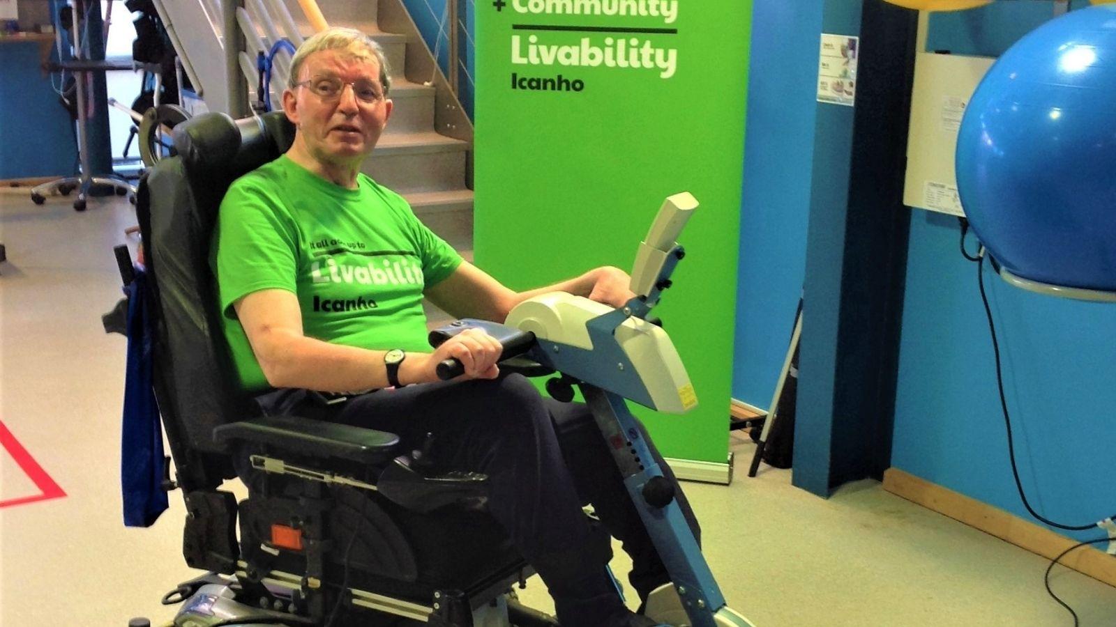 Ian using assistive bike at Icanho